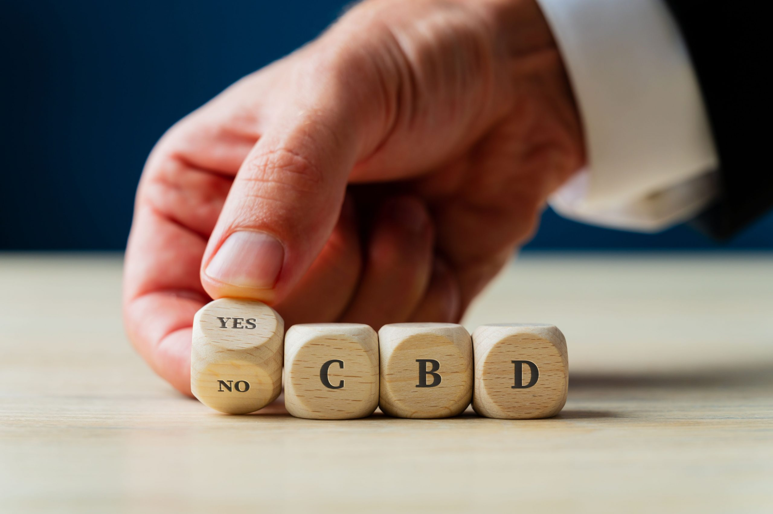 wooden dice spelling out CBD